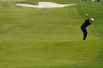 Dustin Johnson hits from the fairway on the fourth hole during the final round of the PGA Championship golf tournament at TPC Harding Park Sunday, Aug. 9, 2020, in San Francisco. (AP Photo/Jeff Chiu)
