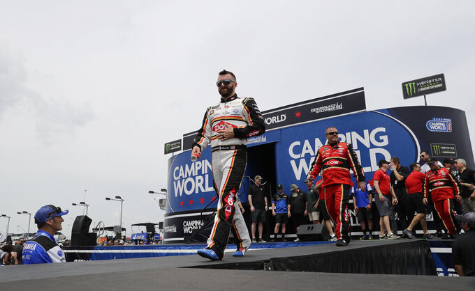 Austin Dillon walks on the stage during drivers introduction before the NASCAR Cup Series auto race at Chicagoland Speedway in Joliet, Ill., Sunday, June 30, 2019. (AP Photo/Nam Y. Huh)