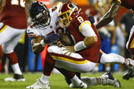 Chicago Bears linebacker Khalil Mack (52) hits Washington Redskins quarterback Case Keenum (8) during the first half of an NFL football game Monday, Sept. 23, 2019, in Landover, Md. (AP Photo/Patrick Semansky)