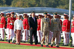Myanmar's President Win Myint, left, and Chinese President Xi Jinping, center, inspect an honor guard during a welcome ceremony at the Presidential Palace in Naypyitaw, Myanmar, Friday, Jan. 17, 2020. (AP Photo/Aung Shine Oo)
