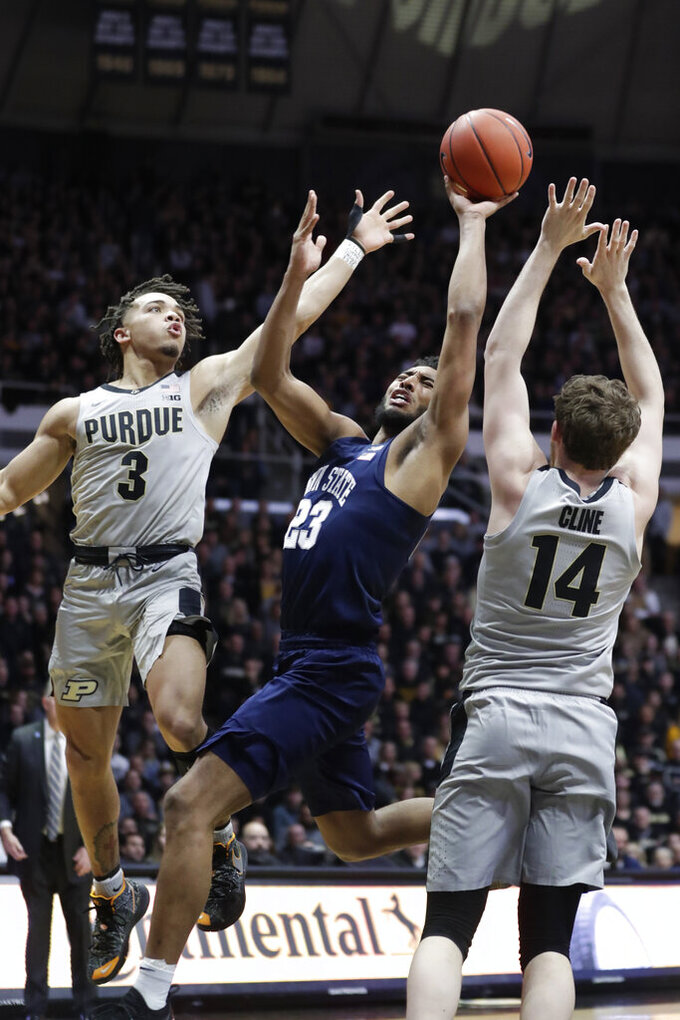 Penn State guard Josh Reaves (23) shoots between Purdue guard Carsen Edwards (3) and guard Ryan Cline (14) during the first half of an NCAA college basketball game in West Lafayette, Ind., Saturday, Feb. 16, 2019. (AP Photo/Michael Conroy)