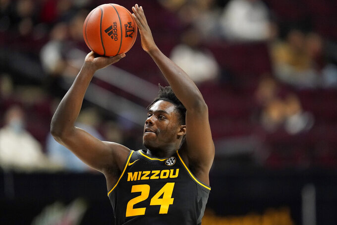 FILE - In this Jan. 16, 2021, file photo, Missouri forward Kobe Brown shoots against Texas A&M during the first half of an NCAA college basketball game in College Station, Texas. Brown and Javon Pickett are the only Tigers who played regular minutes last year. (AP Photo/Sam Craft, File)