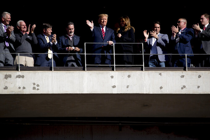 President Donald Trump and first lady Melania Trump wave during a NCAA college football game between LSU and Alabama at Bryant-Denny Stadium, in Tuscaloosa, Ala., Saturday, Nov. 9, 2019. (AP Photo/Andrew Harnik)
