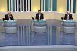 In this picture made available by Young Journalists Club, YJC, presidential candidates of the June 18, elections Mohsen Mehralizadeh, left, Amir Hossein Ghazizadeh Hashemi, center, and Saeed Jalili, attend the second TV debate of the candidates in a state-run TV studio, in Tehran, Iran, Tuesday, June 8, 2021. Iran's seven presidential candidates on Tuesday put all the problems of the Islamic Republic squarely on the shoulders of the one man who wasn't there to defend himself: Outgoing President Hassan Rouhani. (Morteza Fakhri Nezhad/ Young Journalists Club, YJC via AP)