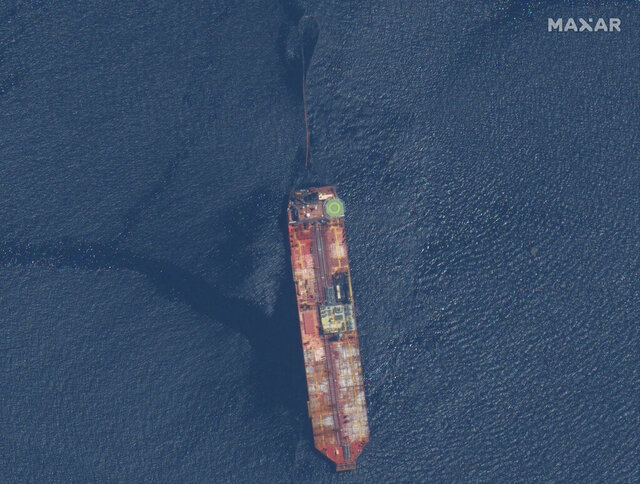 FILE - In this Aug. 9, 2020 file satellite image released by Maxar Technologies shows the FSO Nabarima oil tanker off the coast of Trinidad and Tobago, Sunday, Aug. 9, 2020. The damaged Venezuelan oil tanker recently tilting to one side in the Caribbean after taking on water poses no significant risk of spilling and causing an environmental catastrophe, officials of Trinidad & Tobago said Thursday, Oct. 22. (Maxar Technologies via AP, File)