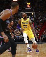 Los Angeles Lakers forward LeBron James dribbles the ball during the first half of the team's NBA basketball game against Miami Heat, Sunday, Nov. 18, 2018, in Miami. (AP Photo/Brynn Anderson)
