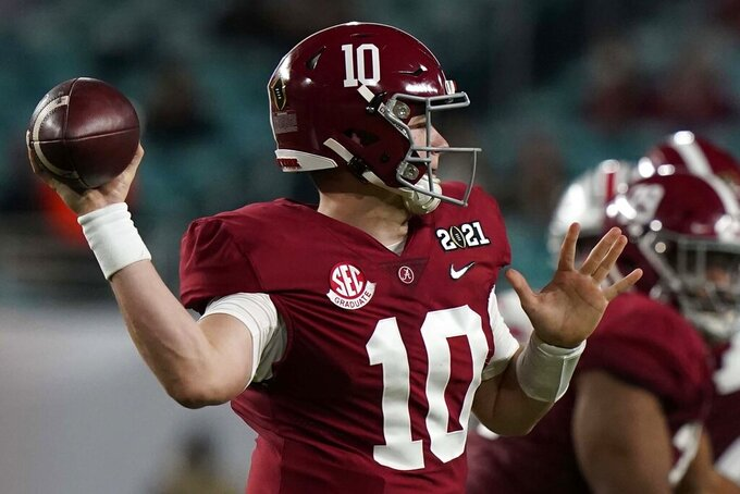 Alabama quarterback Mac Jones passes against Ohio State during the first half of an NCAA College Football Playoff national championship game, Monday, Jan. 11, 2021, in Miami Gardens, Fla. (AP Photo/Lynne Sladky)