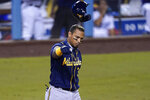 Milwaukee Brewers' Orlando Arcia tosses his helmet after striking out during the eighth inning in Game 1 of the team's National League wild-card baseball series against the Los Angeles Dodgers on Wednesday, Sept. 30, 2020, in Los Angeles. (AP Photo/Ashley Landis)