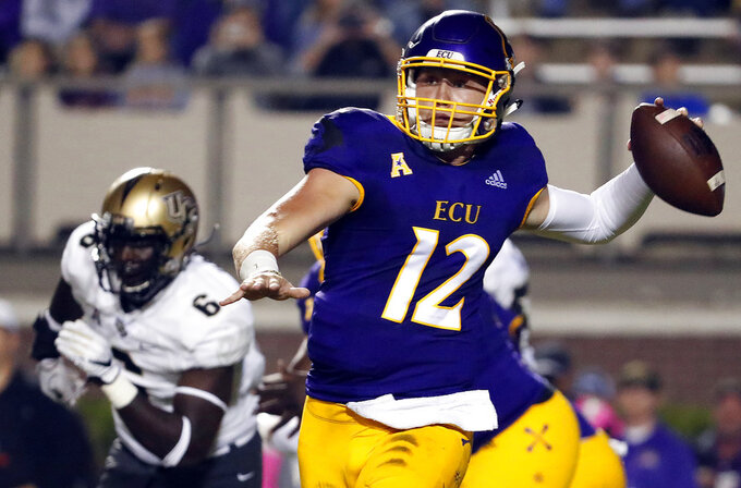 East Carolina's Holton Ahlers (12) looks to pass the ball during the first half of an NCAA college football game against the Central Florida in Greenville, N.C., Saturday, Oct. 20, 2018. (AP Photo/Karl B DeBlaker)