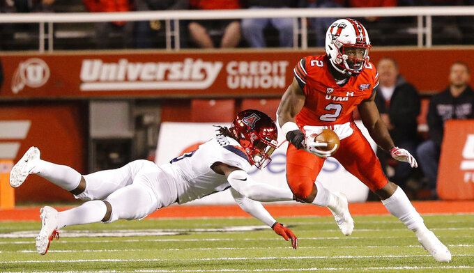 Utah running back Zack Moss (2) eludes Arizona safety Demetrius Flannigan-Fowles (6) during the first half during an NCAA college football game Friday, Oct. 12, 2018, in Salt Lake City. (AP Photo/Rick Bowmer)