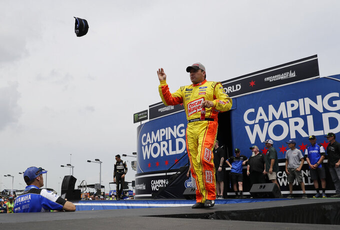 Ryan Newman throws a cap to the crowd during driver introductions before a NASCAR Cup Series auto race at Chicagoland Speedway in Joliet, Ill., Sunday, June 30, 2019. (AP Photo/Nam Y. Huh)