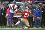 FILE - In this Jan. 11, 2020, file photo, Minnesota Vikings wide receiver Stefon Diggs (14) catches a touchdown pass in front of San Francisco 49ers cornerback Ahkello Witherspoon (23) during the first half of an NFL divisional playoff football game in Santa Clara, Calif. A person with direct knowledge of the move confirms to The Associated Press that the Buffalo Bills have acquired Diggs in a trade with Vikings. (AP Photo/Marcio Jose Sanchez, File)