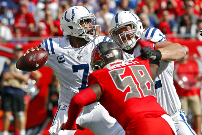 Indianapolis Colts quarterback Jacoby Brissett (7) looks to pass as offensive tackle Braden Smith (72) blocks Tampa Bay Buccaneers linebacker Shaquil Barrett (58) during the first half of an NFL football game Sunday, Dec. 8, 2019, in Tampa, Fla. (AP Photo/Mark LoMoglio)