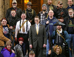 FILE - In this Jan. 15, 2015, file photo, Washington Rep. Matt Shea, R-Spokane Valley, center, poses for a group photo with gun owners inside the Capitol in Olympia, Wash., following a gun-rights rally. Recently published internet chats from 2017 show Shea and three other men discussing confronting