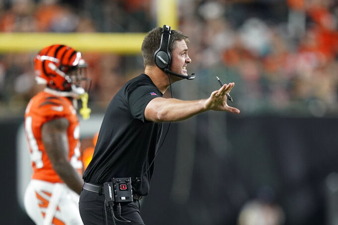 Cincinnati Bengals head coach Zac Taylor shouts during the first half of an NFL football game against the Jacksonville Jaguars, Thursday, Sept. 30, 2021, in Cincinnati. (AP Photo/Bryan Woolston)