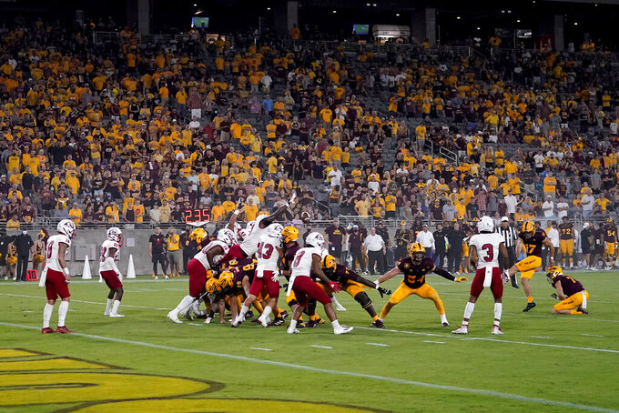 Southern Utah blocks a pointer after attempt by Arizona State punter Logan Tyler (17) during the first half of an NCAA college football game, Thursday, Sept. 2, 2021, in Tempe, Ariz. (AP Photo/Matt York)