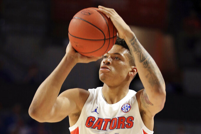 FILE - In this Jan. 25, 2020, file photo, Florida forward Keyontae Johnson (11) takes a shot against Baylor during the first half of an NCAA college basketball game in Gainesville, Fla. Johnson hasn't practiced or played since collapsing on the court last December. (AP Photo/Matt Stamey, File)