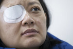 In this Wednesday, Dec. 4, 2019, photo, Veby Mega Indah, an injured Indonesian video journalist, speaks during an interview with The Associated Press in the Wan Chai area of Hong Kong. More than two months after being blinded in one eye by what she believes was a projectile fired by riot police, Indah is still seeking answers. On Sept. 29, 2019, Indah was among a group of reporters covering one of the hundreds of clashes between armed police and anti-government protesters that have broken out almost daily over the past six months. (AP Photo/Vincent Thian)