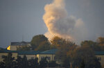Smoke rises after shelling by Azerbaijan's artillery during a military conflict, in Stepanakert, the separatist region of Nagorno-Karabakh, Thursday, Oct. 29, 2020. Fighting over the separatist territory of Nagorno-Karabakh continued on Thursday, as the latest cease-fire agreement brokered by the U.S. failed to halt the flare-up of a decades-old conflict between Armenia and Azerbaijan. (AP Photo)