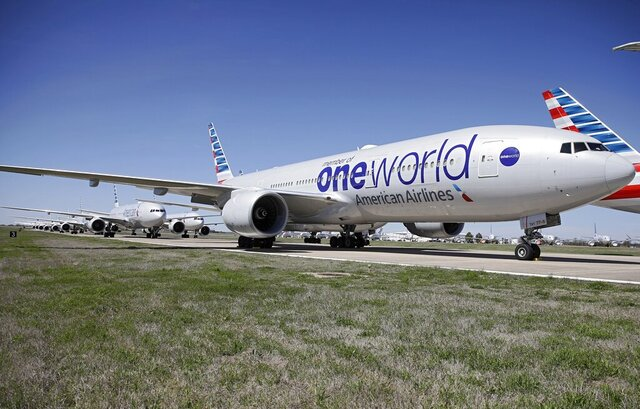 American Airlines 777's airplanes are parked at Tulsa International Airport Wednesday, March 25, 2020. American Airlines has 44 out of service airplanes parked at the airport due to a reduced flight schedule because of the COVID-19 pandemic. (Mike Simons/Tulsa World via AP)