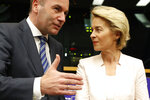Germany's Ursula von der Leyen and Germany's Manfred Weber arrive for a joint press conference at the European Parliament in Strasbourg, eastern France, Wednesday July 3, 2019. On Tuesday, EU leaders nominated Germany's Ursula von der Leyen to become president of the executive Commission. (AP Photo/Jean-Francois Badias)