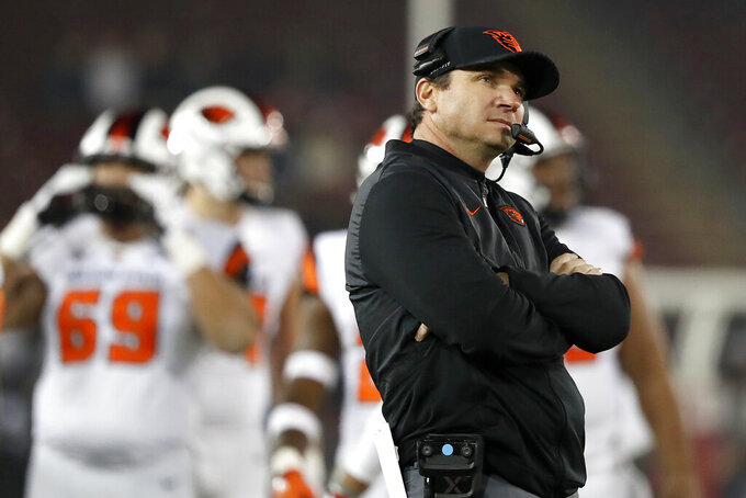 FILE - In this Nov. 10, 2018, file photo, Oregon State head coach Jonathan Smith looks at the scoreboard during a timeout against Stanford in the second half during an NCAA college football game in Stanford, Calif. The Beavers open the season at home against Washington State on Nov. 7. (AP Photo/Tony Avelar, File)