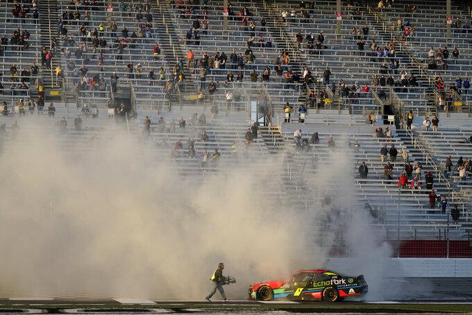 NASCAR driver Justin Allgaier celebrates after a win after a NASCAR Xfinity Series at Atlanta Motor Speedway on Saturday, March 20, 2021, in Hampton, Ga. (AP Photo/Brynn Anderson)