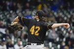 Pittsburgh Pirates starting pitcher JT Brubaker throws during the first inning of a baseball game against the Milwaukee Brewers Friday, April 16, 2021, in Milwaukee. (AP Photo/Morry Gash)