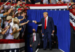 President Donald Trump arrives to speaks at a campaign rally at Williams Arena in Greenville, N.C., Wednesday, July 17, 2019. (AP Photo/Carolyn Kaster)