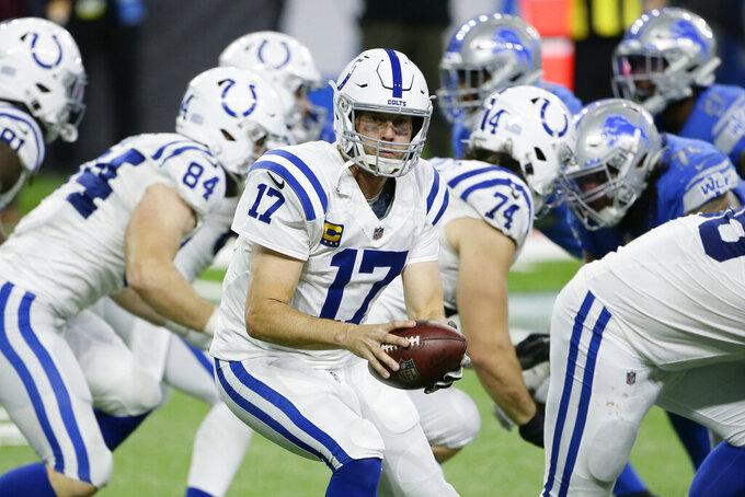 Indianapolis Colts quarterback Philip Rivers prepares to hand off during the second half of an NFL football game against the Detroit Lions, Sunday, Nov. 1, 2020, in Detroit. (AP Photo/Duane Burleson)