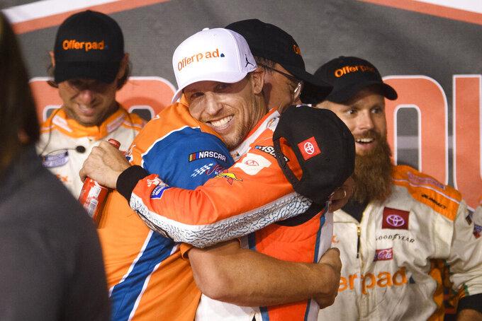 Denny Hamlin celebrates after winning a NASCAR Cup Series auto race Sunday, Sept. 5, 2021, in Darlington, S.C. (AP Photo/John Amis)