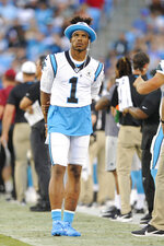 Carolina Panthers quarterback Cam Newton walks the sidelines during the first half an NFL preseason football game against the Buffalo Bills, Friday, Aug. 16, 2019, in Charlotte, N.C. (AP Photo/Mike McCarn)
