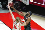 Oregon State forward Rodrigue Andela, right, lays the ball up as Utah center Branden Carlson (35) defends during the second half of an NCAA college basketball game Wednesday, March 3, 2021, in Salt Lake City. (AP Photo/Rick Bowmer)