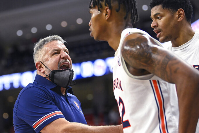 Auburn coach Bruce Pearl talks to guard Lior Berman (12) at the end of the first half of the team's NCAA college basketball game against Missouri on Tuesday, Jan. 26, 2021, in Auburn, Ala. (AP Photo/Julie Bennett)