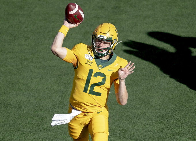 Baylor quarterback Charlie Brewer (12) throws the ball against Texas during an NCAA college football game on Saturday, Nov. 23, 2019, in Waco, Texas. (Nick Wagner/Austin American-Statesman via AP)