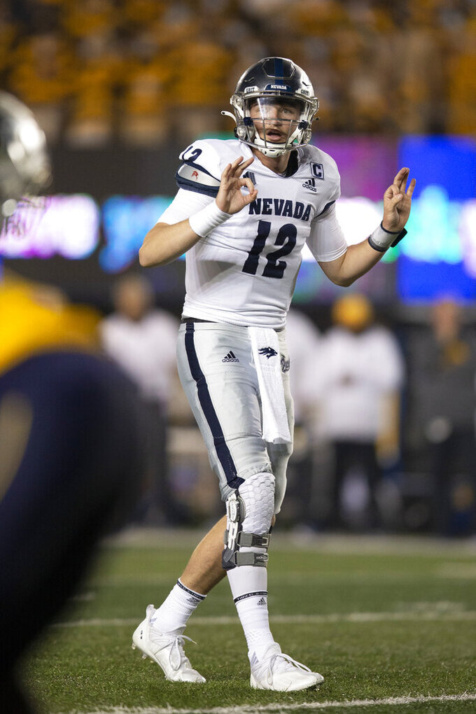 Nevada quarterback Carson Strong calls signals to teammates during the second quarter of an NCAA college football game against California, Saturday, Sept. 4, 2021, in Berkeley, Calif. (AP Photo/D. Ross Cameron)