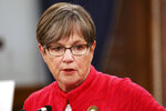 Kansas Gov. Laura Kelly speaks to reporters during a news conference, Wednesday, July 28, 2021, at the Statehouse in Topeka, Kan. Kelly is imposing a mask mandate for state government workers and visitors to state buildings in most of Kansas' 105 counties. (AP Photo/John Hanna)