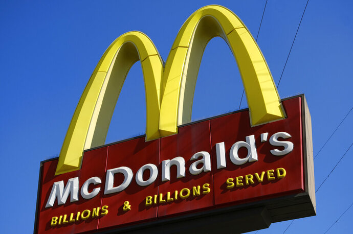 FILE - This Nov. 25, 2019, file photo shows McDonald's sign above the fast food restaurant near downtown Los Angeles. The Labor Department issued a final rule Sunday, Jan. 12, 2020, that clarifies when a worker is employed by more than one company, an issue that affects franchise businesses such as McDonald's and firms that have outsourced services such as cleaning and maintenance. (AP Photo/Richard Vogel, File)