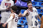Gonzaga forward Corey Kispert (24) and Drew Timme (2) congratulate each other in the second half of a Sweet 16 game against Creighton in the NCAA men's college basketball tournament at Hinkle Fieldhouse in Indianapolis, Sunday, March 28, 2021. Gonzaga won 83-65. (AP Photo/Michael Conroy)