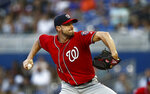 Washington Nationals starting pitcher Max Scherzer (31) delivers during the first inning of a baseball game against the Miami Marlins on Saturday, April 20, 2019, in Miami. (AP Photo/Brynn Anderson)