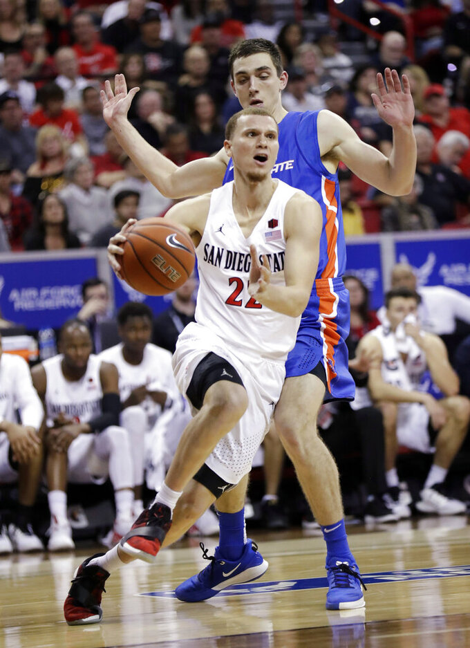 San Diego State's Malachi Flynn (22) drives to the hoop as Boise State's Justinian Jessup defends during the second half of an NCAA college basketball game in the Mountain West Conference men's tournament Friday, March 6, 2020, in Las Vegas. (AP Photo/Isaac Brekken)