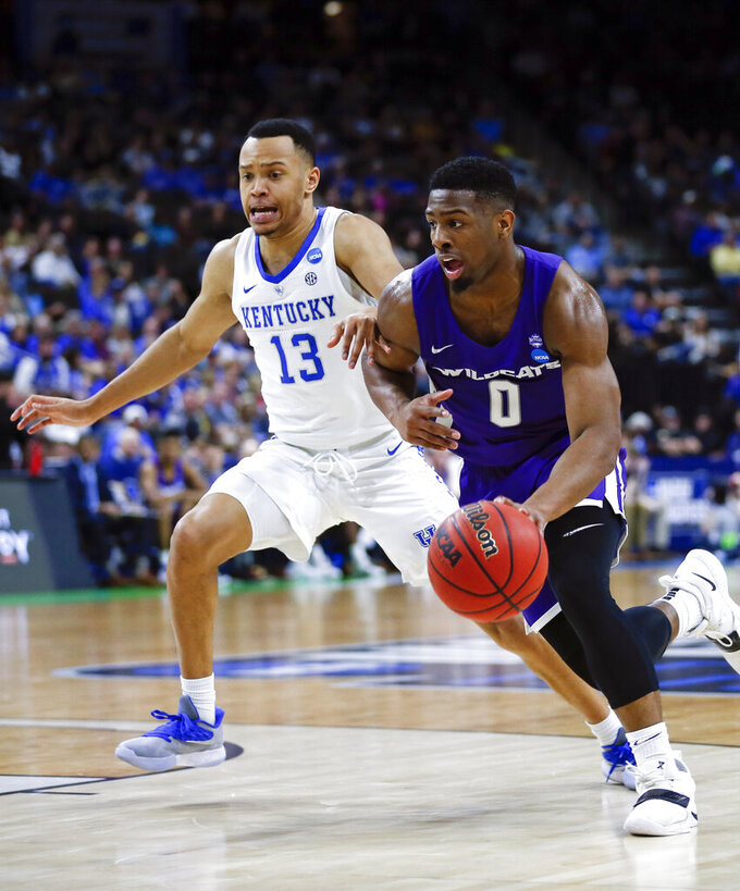 Abilene Christian's Jaylen Franklin (0) drives to the basket Kentucky's Jemarl Baker Jr. (13) during the first half of a first-round game in the NCAA men's college basketball tournament in Jacksonville, Fla., Thursday, March 21, 2019. (AP Photo/Stephen B. Morton)