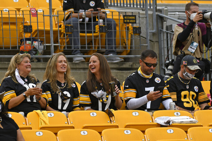 Pittsburgh Steelers fans sit without masks during the first half of an NFL football game between the Pittsburgh Steelers and the Philadelphia Eagles in Pittsburgh, Sunday, Oct. 11, 2020. It is the first game that some 5000 fans have been allowed to attend. (AP Photo/Don Wright)