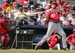 Washington Nationals' Max Scherzer (31) reacts while at bat during an exhibition spring training baseball game against the St. Louis Cardinals on Monday, March 11, 2019, in Jupiter, Fla. (AP Photo/Brynn Anderson)