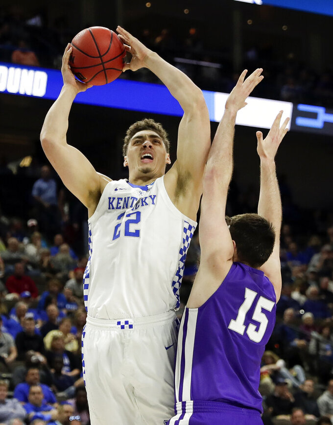 Kentucky's Reid Travis (22) shoots over Abilene Christian's Hayden Farquhar (15) during the first half of a first-round game in the NCAA men's college basketball tournament in Jacksonville, Fla. Thursday, March 21, 2019. (AP Photo/John Raoux)