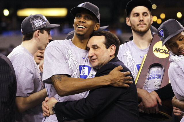 FILE - In this April 5, 2010, file photo, Duke head coach Mike Krzyzewski and guard Lance Thomas embrace after Duke's 61-59 win over Butler in the men's NCAA Final Four college basketball championship game, in Indianapolis. The 2010s had some of the greatest NCAA Tournament games in college basketball history, from Duke's epic win over Butler in 2010 to Villanova's last-second win over North Carolina in 2016. (AP Photo/Michael Conroy, File)