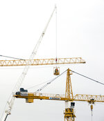 Workers go up to inspect the two unstable cranes before implosion at the Hard Rock Hotel construction site in New Orleans, Friday, Oct. 18, 2019. The Hard Rock Hotel partially collapsed last week. (Sophia Germer/The Advocate via AP)/