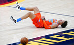 Oklahoma City Thunder forward Isaiah Roby reacts after stealing the ball from Denver Nuggets center Nikola Jokic but then losing control of the ball while heading down the court in the second half of an NBA basketball game Tuesday, Jan. 19, 2021, in Denver. (AP Photo/David Zalubowski)