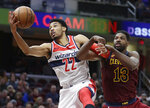 Washington Wizards' Otto Porter Jr. (22) grabs a loose ball ahead of Cleveland Cavaliers' Tristan Thompson (13) during the second half of an NBA basketball game, Saturday, Dec. 8, 2018, in Cleveland. The Cavaliers won 116-101. (AP Photo/Tony Dejak)