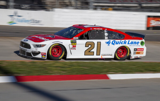 Paul Menard races for position during qualifying for the NASCAR Monster Energy Cup Series race at Martinsville Speedway in Martinsville, Va., Saturday, March 23, 2019. (AP Photo/Matt Bell)